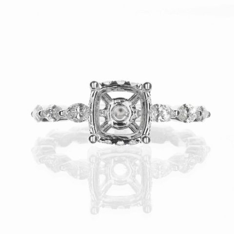 Diamond accent engagement ring with hidden halo and marquise diamond band