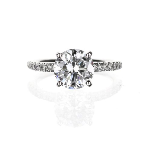Round diamond accent engagement ring with 2.15 carat round diamond