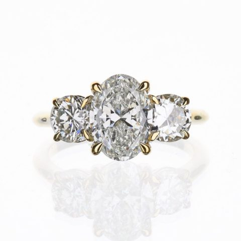 Oval and Round Diamond Three Stone Engagement Ring Yellow Gold