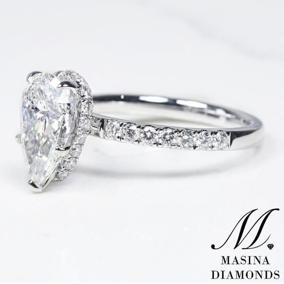 Pear Shape Engagement Ring Hidden Halo