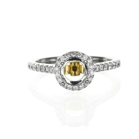 Two tone round halo engagement ring setting in 18 karat white and yellow gold