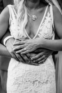Married Couple holding each other on wedding day