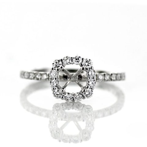 Dainty cushion halo engagement ring