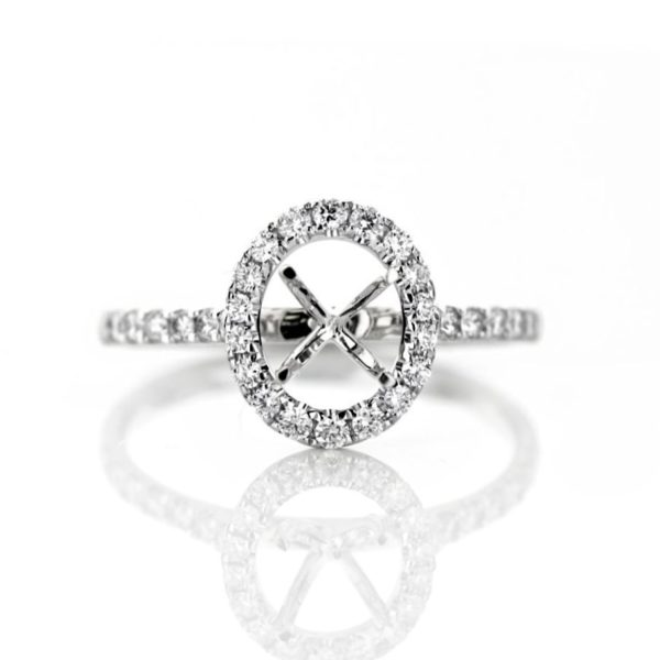 Dainty oval halo engagement Ring